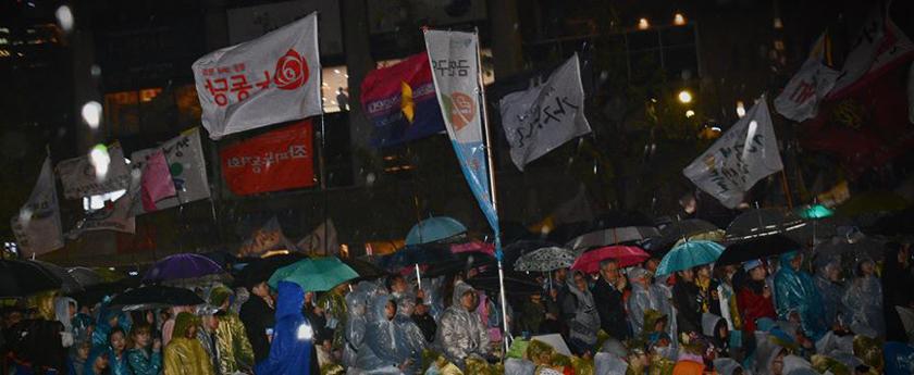 Protest vigil in the pouring rain at Gwanghwamun in Seoul.