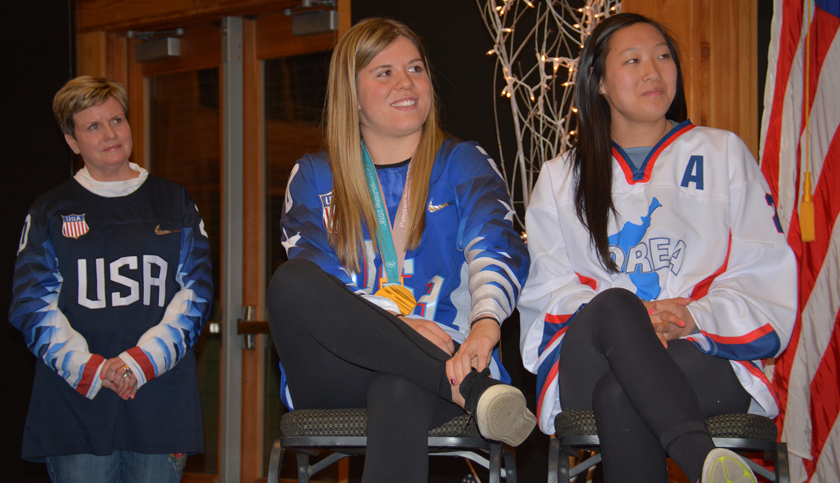 Sisters and Olympic Women's hockey team athletes, Hannah and Marissa Brandt at their hometown reception in Vadnais Heights, Minnesota with their mother, Robin Brandt looking on.