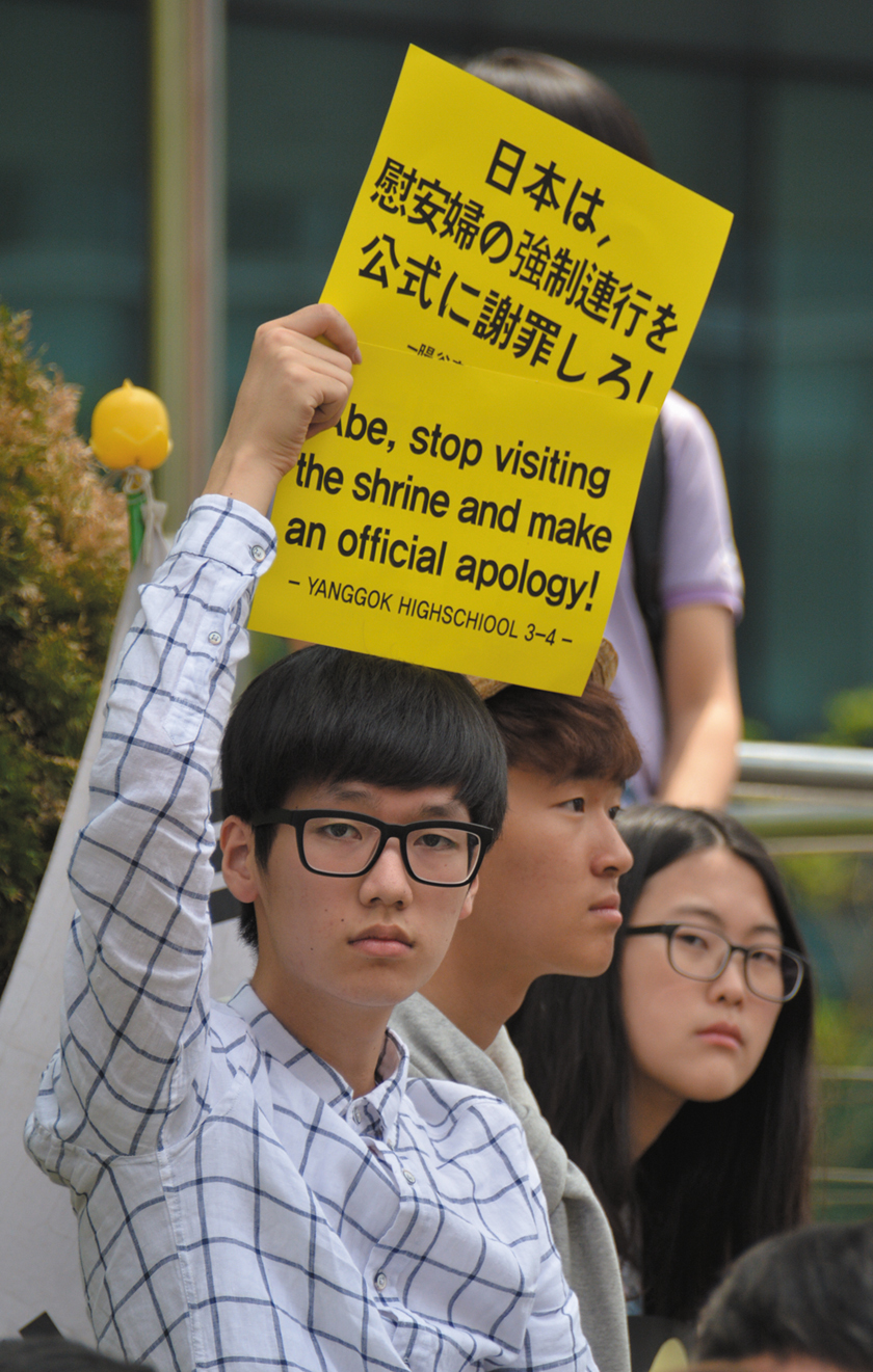 Students participate in one of the comfort women weekly vigils in front of the Japanese embassy in Seoul.