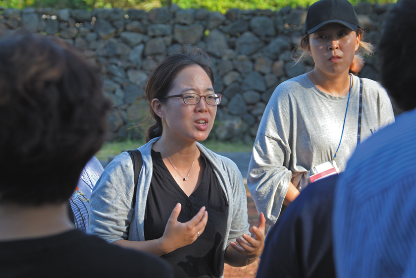 The Jeju Uprising and Dark Tours.   Gayoon Baek, founder of Jeju Dark Tours leads a  group of high school students to various sites.