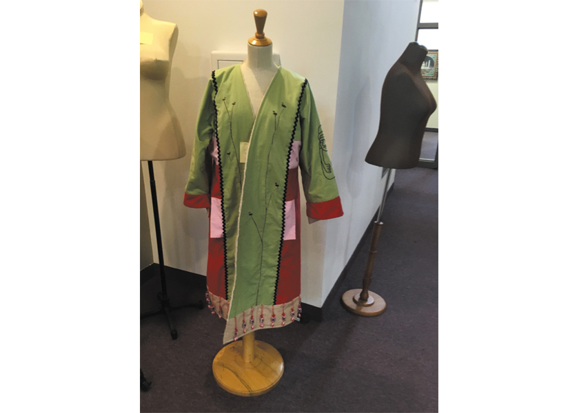 Artist Dawn Tomlinson and her jacket she designed using inspiration from her Korean heritage.