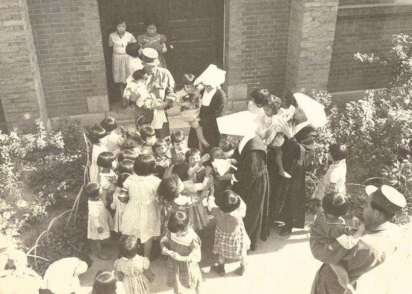 American GI's visit an orphanage near Bupyeong, South Korea