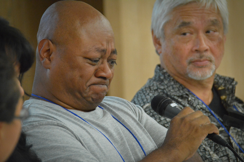 Adopted Korean Mosiac Hapa tour conference panelist Chang Lee Nielsen of Denmark with Samuel Townsend looking on.