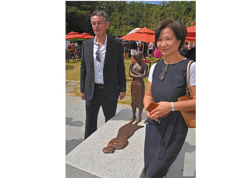 "Adopted Korean Mosiac Hapa tour:  Thomas Park Clement and artist Wonsook Kim who created the sculpture ""Shadow Child"" for Omma Poom Park, Paju, South Korea."