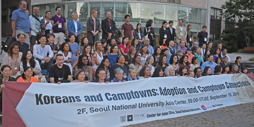 Adopted Korean Mosiac Hapa tour conference members pose in fron of the Asian Center at Seoul National University.