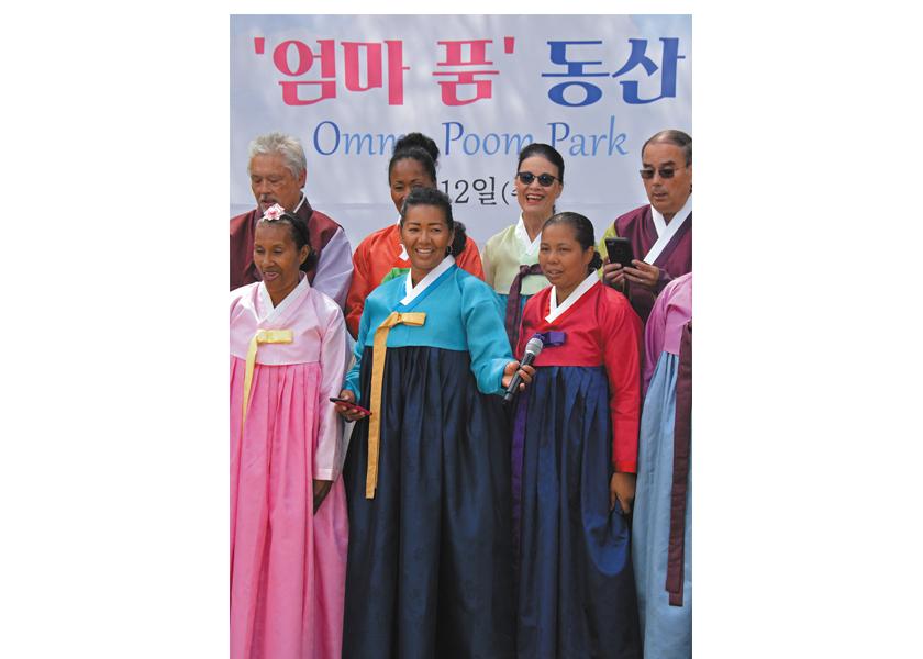 Adopted Korean Mosiac Hapa tour members sang together at the Omma Poom Park dedication near Paju, South Korea.